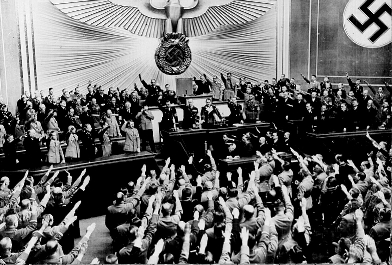 """""""Hitler accepts the ovation of the Reichstag after announcing the `peaceful' acquisition of Austria. It set the stage to annex the Czechoslovakian Sudetenland, largely inhabited by a German- speaking population."""" Berlin, March 1938."""